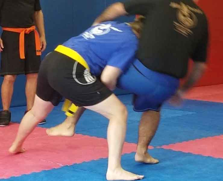 adult grappling demonstration in self defense class