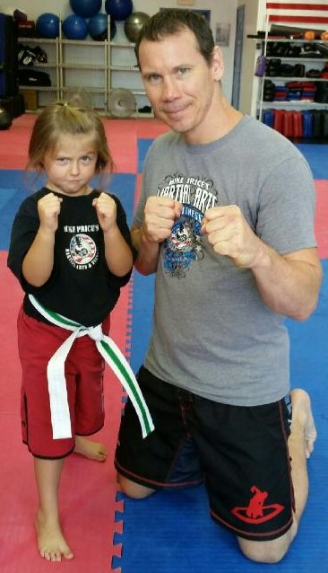 Mike with little girl doing martial arts