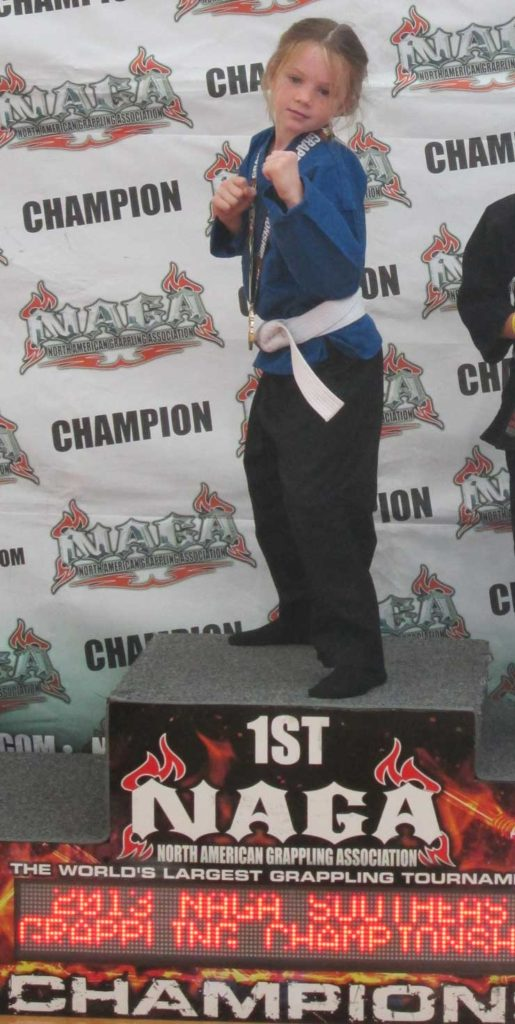 Ava showing off her NAGA championship win