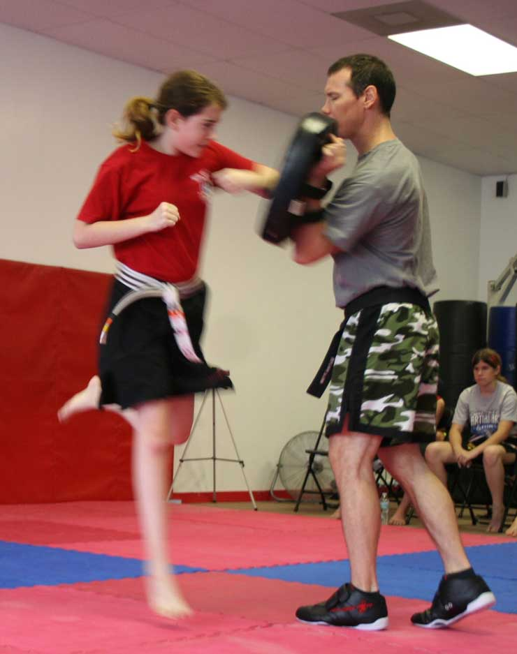 Donnie demonstrating the flying elbow punch during martial arts class