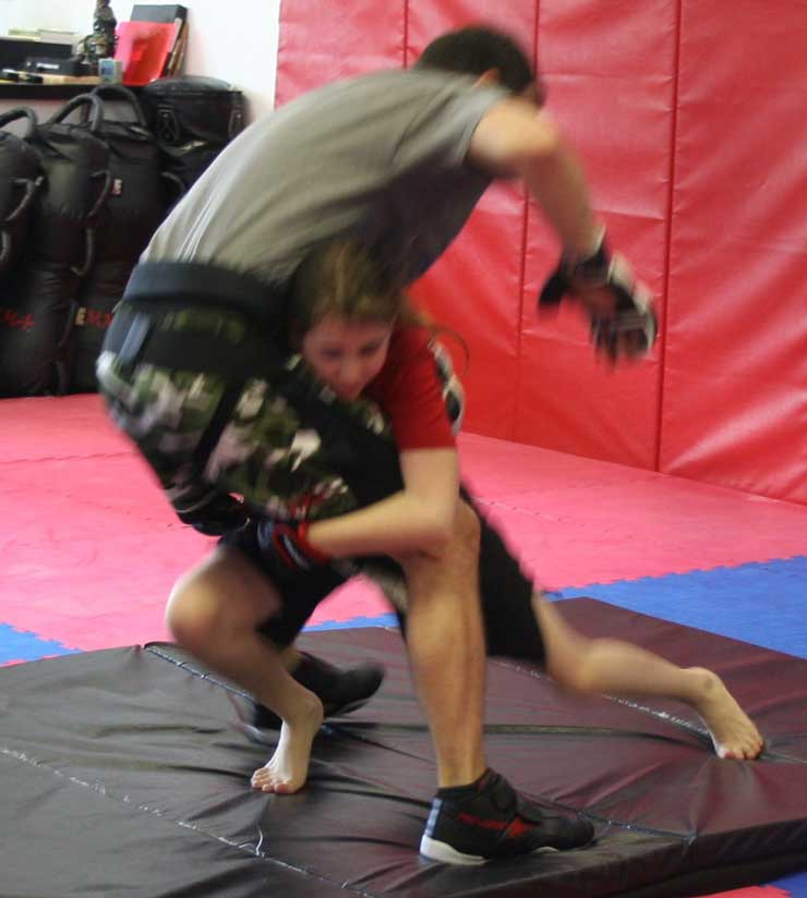 double leg take down demonstration at Mike Price's Martial arts class