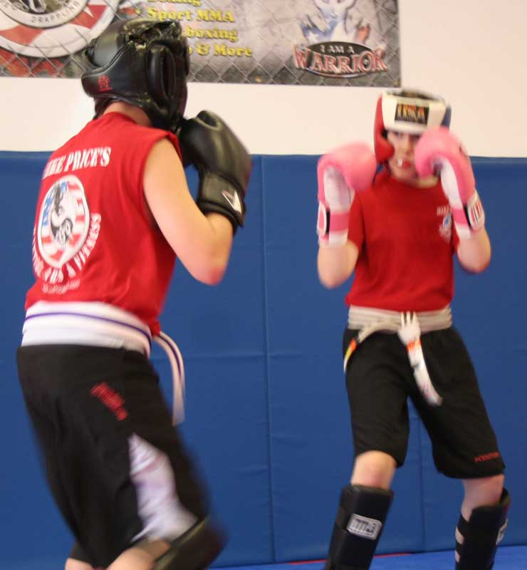 juniors kickboxing during martial arts class