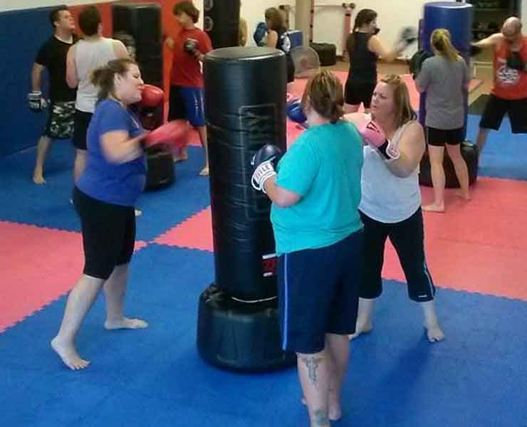 ladies hitting boxing fitness class