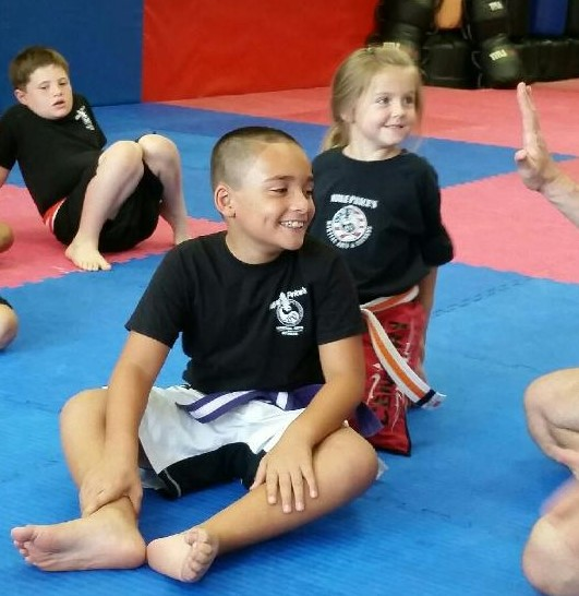 It's all smiles on these kids faces while learning Martial Arts at Mike Price's Martial Arts and Fitness